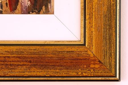 wall angle corner: angle of yellow painting frame closeup macro Stock Photo