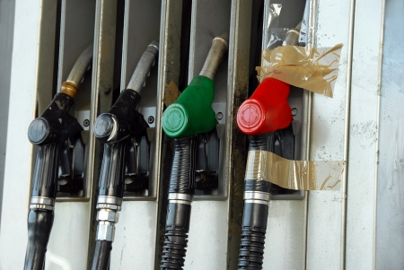 various colorful gas pumps row closeup concept photo
