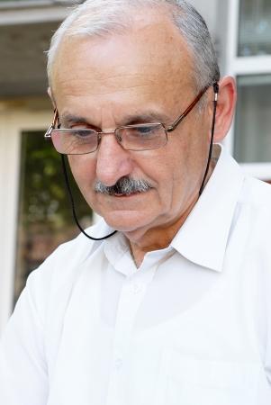 calm down: portrait of caucasian mature man in glasses outdoors