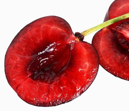 ruby red: one ripe red cherry on white background Stock Photo
