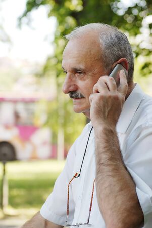 portrait of caucasian mature man with mobile phone Stock Photo - 14383878