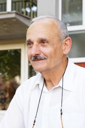 portrait of caucasian mature man smiling outdoors photo