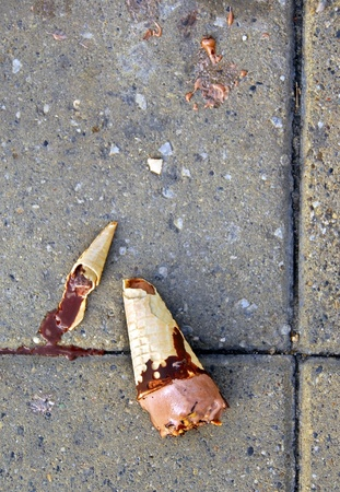 disillusionment: dropped broken chocolate ice-cream melting on street