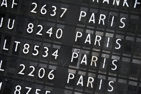 often: flights into Paris on black information table at airport