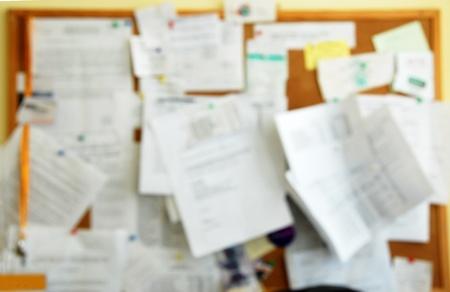 near sighted: Blur reminder board with papers in office