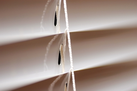 venetian blind: window blinds fragment with a cord macro Stock Photo