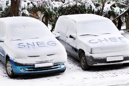 serbian latin and cyrillic letters written on automobiles covered by snow at winter outdoors