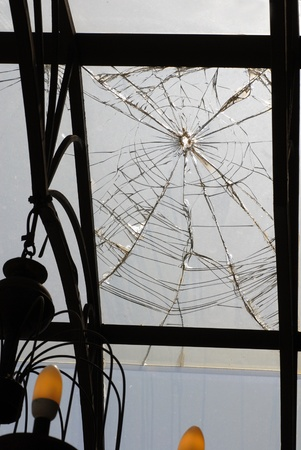 broken glass fragment on ceiling of porch, architecture details photo