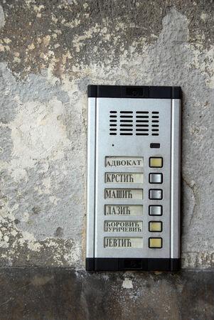 interphone: metallic interphone on old wall with serbian surnames