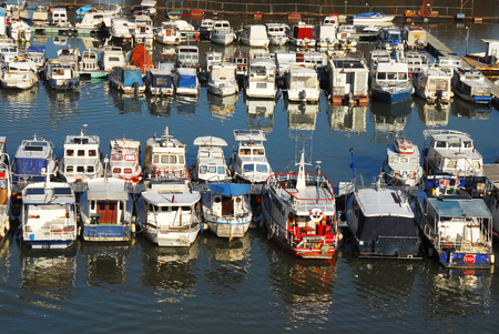 anchoring: various parked boats in row on Sava river in Belgrade, Serbia