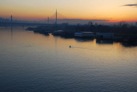 house float on water: sunset over Sava river in Belgrade, Serbia Stock Photo