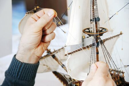 accurately: making details of wooden handmade boat closeup