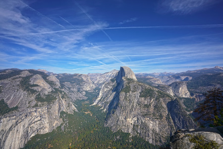Panoramic view of the mountain range in Yosemite National Park with Half Dome in the center