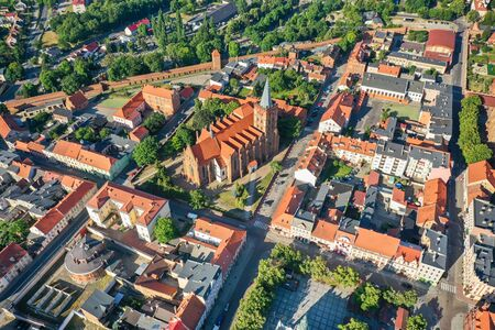 Aerial view of a Gothic church in a small town in Europe Banco de Imagens