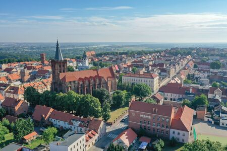 Drone view of an Old Town with gothic church in the foreground Фото со стока