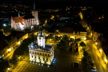 Night, drone view of a Town Hall in old town square in Poland
