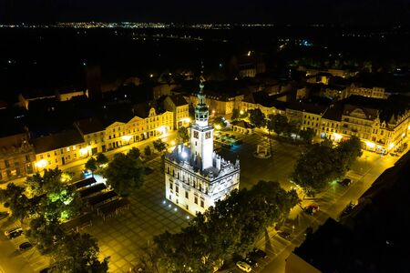 Night view of a Town Hall in the middle of a town square in Europe