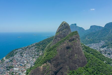 Aerial view of Dois Irmaos with favelas at the foot of the hills in Rio de Janeiro Stock Photo