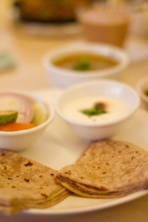 Various Vegetarian Dishes - Yoghurt, Dhal Bean Curry, Chapattis (Indian Cuisine)