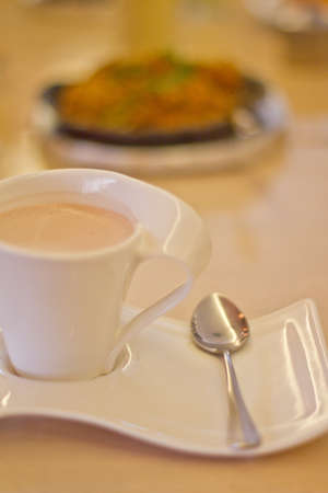 quencher: A Cup of Hot Chocolate with Fancy Cup and Saucer