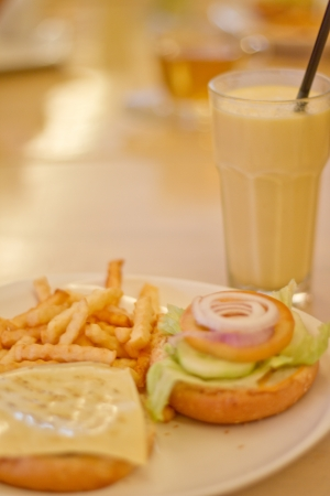 A Vegetarian Burger with Mango Lassi Drink