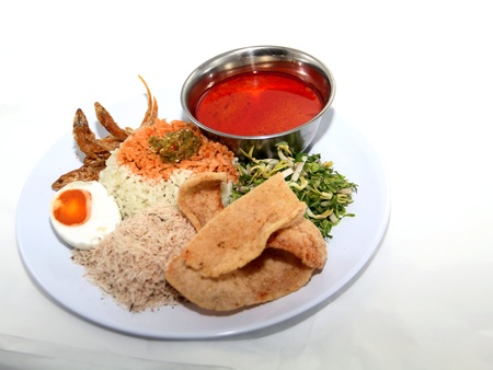 Delicious nasi kerapu on white background