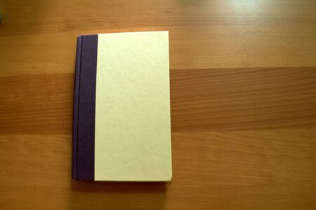 Notebook on wood background Stock Photo