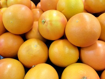 Pile of fresh juicy grapefruit Stock Photo