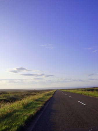 endless road under blue sky Stock Photo
