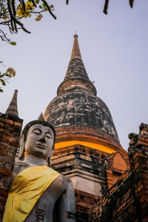 Tourist destination  Buddha statue and the Victory pagoda at Wat Yai Chaimongkol photo