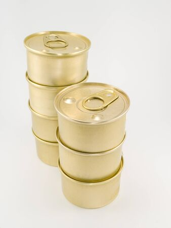 gold cans: Seven gold blank cat food cans with pull tab piled on top of each other against a white background. Stock Photo