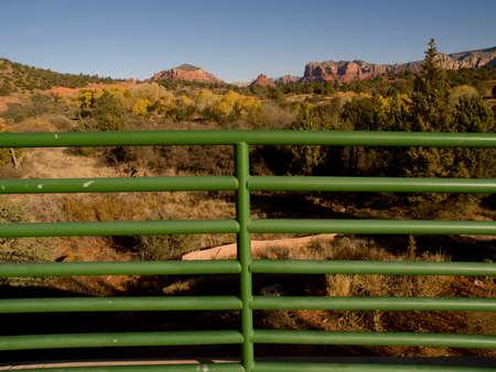 railing: Green railing overlooking Arizona landscape in USA.