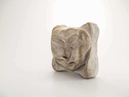 Clay sculpture of angry sleeping scrunched up face on white background. Sculpted by myself, also the photographer, Zeljka Burazin, in 2007, Toronto, Ontario, Canada. Stock Photo