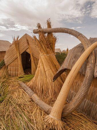 lake dwelling: Straw huts on floating island, Lake Titicaca, Peru.