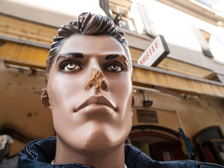 male mannequin: Male mannequin head with broken nose outside store in Sarajevo, Bosnia and Hercegovina, Europe.