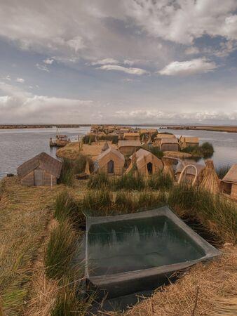 lake dwelling: Floating village made of straw on Lake Titicaca, Peru, South America.