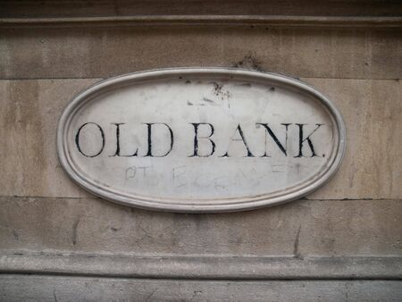 old sign: Old Bank sign in oval shaped marble on stone building in Bristol, United Kingdom, Britain, Europe.