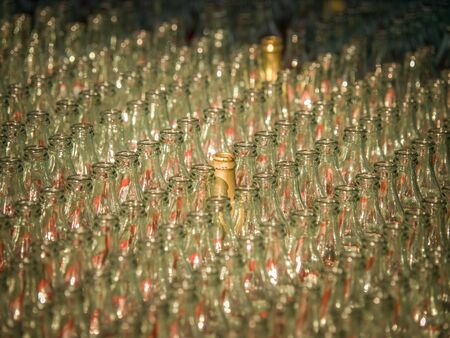 Lines of clear empty coke bottles, where only a few are painted gold, for a ring toss game at the Canadian National Exhibition in Toronto, Ontario, Canada.