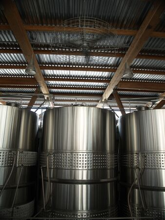 vintages: Large stainless steel wine vats at Jackson Triggs distillery in Niagara on the Lake, Ontario, Canada.
