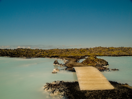 grindavik: Wooden bridge over silica lake just outside of Blue Lagoon Spa in Iceland.