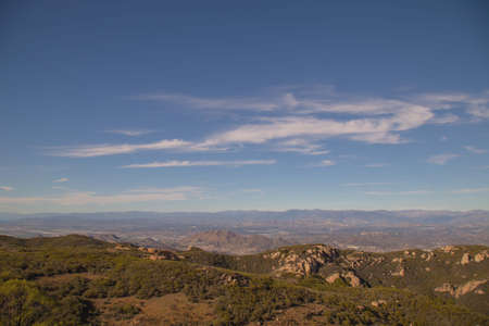 the backbone: View of pacific ocean and green valley on the backbone trail in Ventura, Valley, California. Stock Photo