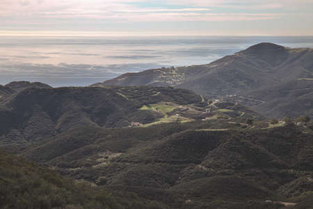 View of pacific ocean and green valley on the backbone trail in Ventura, Valley, California. Stock Photo