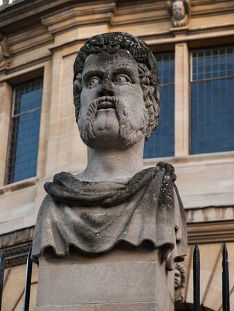 oxford: Stone carved statue at Oxford University, United Kingdom, Europe. Stock Photo