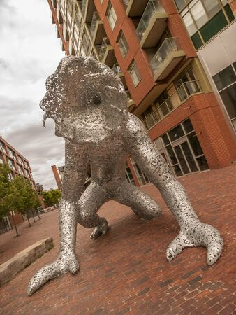 Metal faceless monster sculpture named Koilos by artist Michael Christian located at Distillery Historic District in Toronto, Ontario, Canada. The statue is no longer in place and has been moved elsewhere in Ontario.
