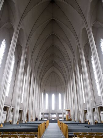 pews: Interior of Hallgrimskirkja Cathedral in Reykjavik Iceland.