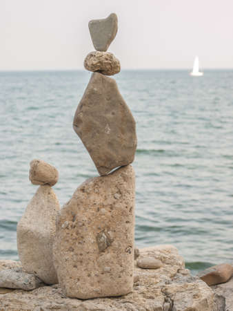 inukshuk: Inukshuk rock piles by Lake Ontario in Oakville, Ontario, Canada. Stock Photo