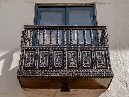 wood molding: Ornate wood carved balcony in Cusco, Peru, South America. Stock Photo