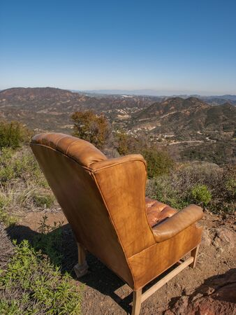 arm chair: Brown leather arm chair on top of a hill with a view of Los Angeles, California, USA.