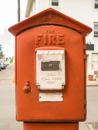 Red tall standing fire alarm box in Boston, Massachusetts, usa.