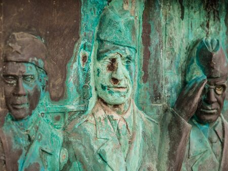 oxidized: Oxidized carving of three army veterans in Skopje, Macedonia, Europe.